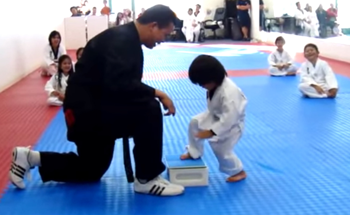Little Boy Trying To Break Board In Taekwond