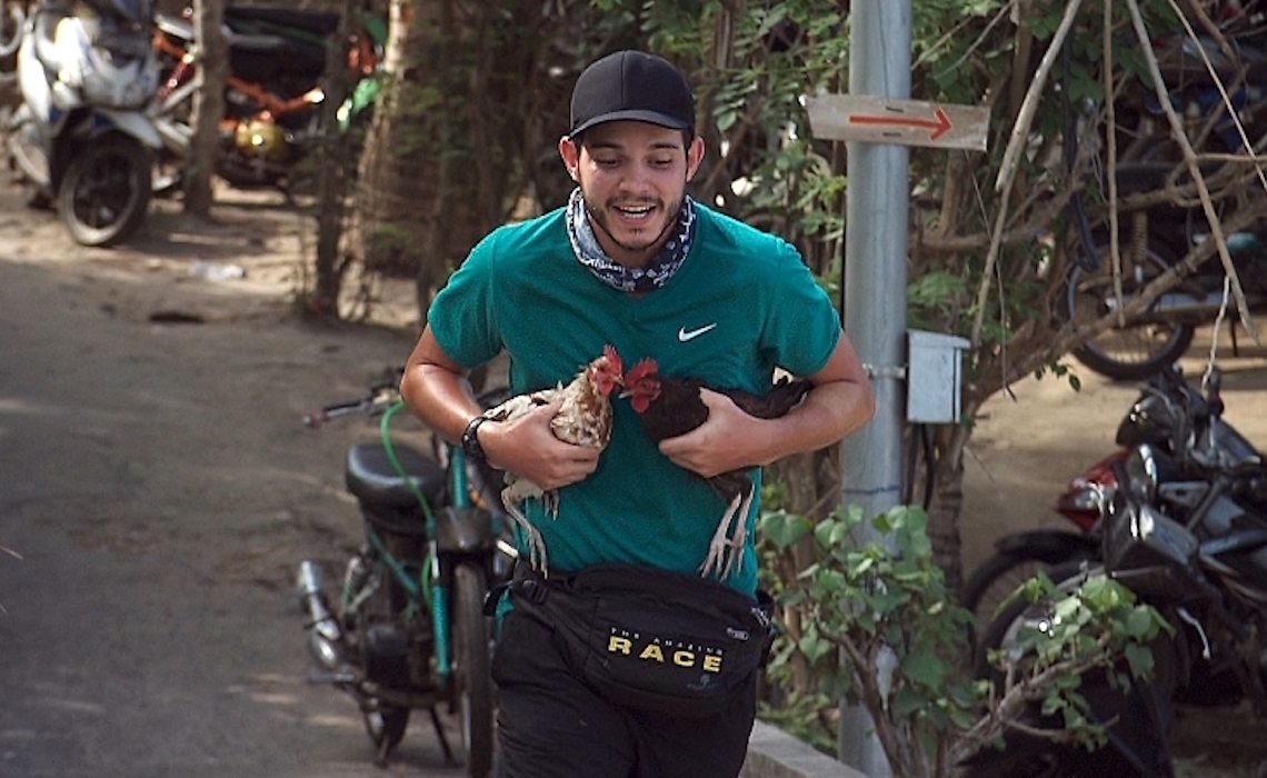 Korey and his chickens.