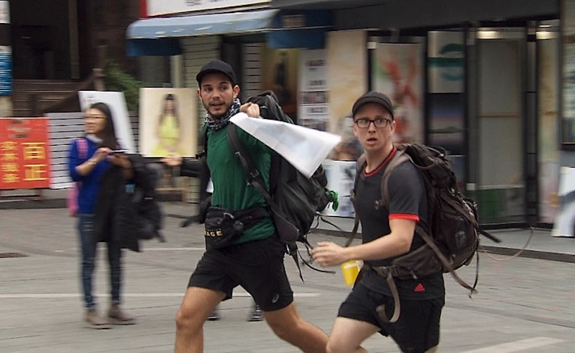 """That's Money, Honey""-- Korey (left) and Tyler (right) make their way to the next location in Shenzhen, China on THE AMAZING RACE, Friday, May 6 (8:00-9:00 PM, ET/PT) on the CBS Television Network. Photo: CBS ©2016 CBS Broadcasting, Inc. All Rights Reserved"