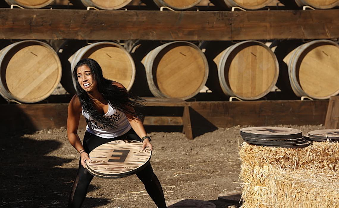 """The Only First That Matters""-- In this Road Block, Dana (pictured) must spell out the names of the cities they have traveled to using letters printed on wine barrel heads on THE AMAZING RACE, Friday, May 13 (8:00-9:00 PM, ET/PT) on the CBS Television Network. Photo: Robert Voets/CBS ©2015 CBS Broadcasting, Inc. All Rights Reserved"