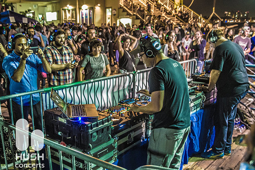Hushfest DJs spinning tracks straight to wireless earphones with nary a sound