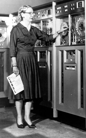 Grace Hopper by some early computers she helped design.