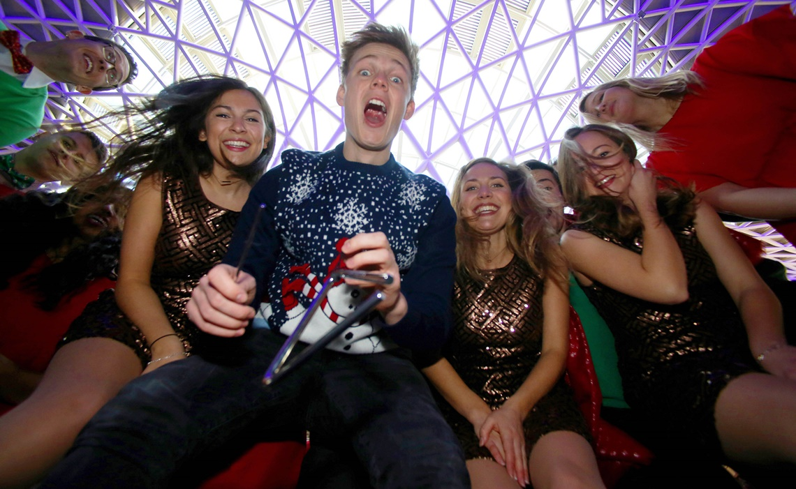 EDITORIAL USE ONLY Youtuber Caspar Lee sings an updated version of the Christmas song 'Deck The Halls' at King's Cross station to launch a TK Maxx campaign aimed at reviving the tradition of carol singing, in London. PRESS ASSOCIATION Photo. Picture date: Wednesday November 30, 2016. Research commissioned by the retailer reveals that although over two-thirds of Britons enjoy Christmas carols, less than half the nation will actually be singing them with many young people feeling embarrassed to do so. Photo credit should read: Geoff Caddick/PA Wire